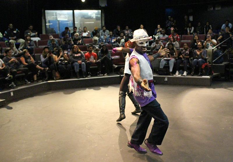 Samba Funk dance crew leader Aytchan King Theo Williams performs on stage with a fellow dancer inside the little theater on Wednesday Nov.11 as part of an event focusing on the African Diaspora