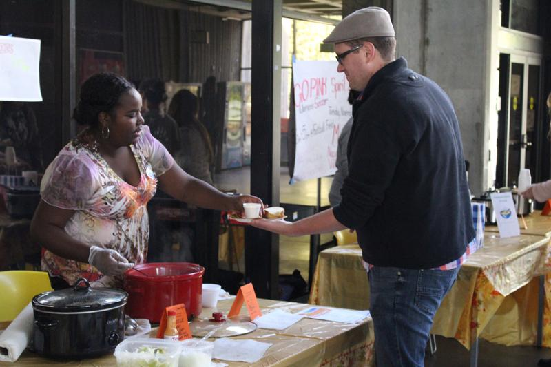 Alex Briggs shares her pepper and carrot soup with Richard Trager at the LMC sixth annual cook-off.