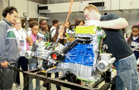 Seventh and Eighth Graders getting information on the Automotive Dept at LMC. Pittsburg, Ca., October 27, 2015. Jason Dearman Professional Mechanic Instructor is giving the kids a talk about what goes on when rebuilding a car engine.