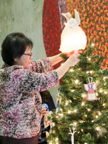 LMC Angel Tree and Toy Drive. Eileen Valenzuela is setting up this years Angel tree in the outside Business offices hallway as they have now for many years. November 30, 2015. Cathie Lawrence/Experience.