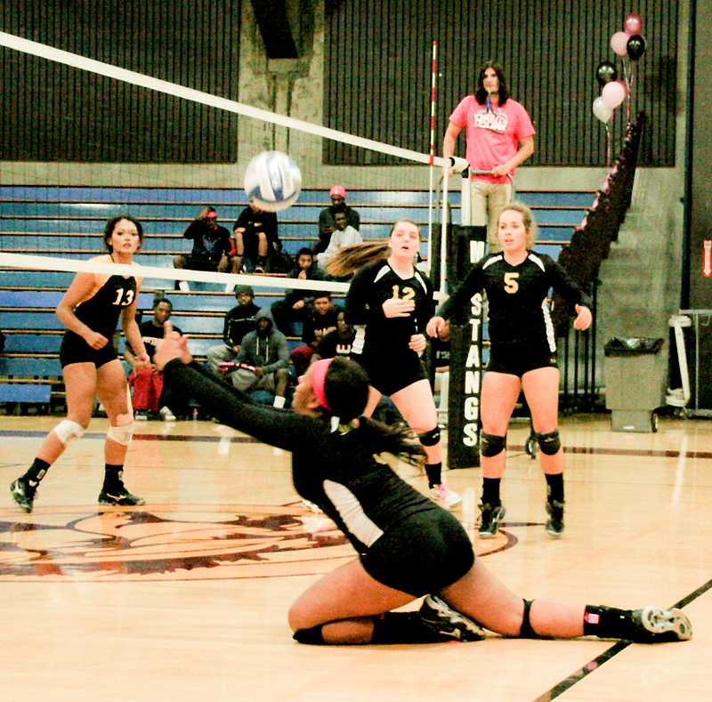 Scriven dives to make a play during an LMC game.