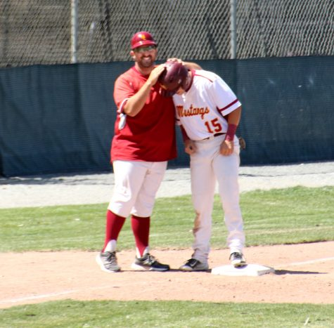 Mens Baseball, LMC vs.Solano Commnunity College. LMC player #15 Jared Ambuehl getting congratulated by coach Anthony for a well played run.LMC, Pittsburg, Calif. April 23, 2016. Cathie Lawrence/Experience.