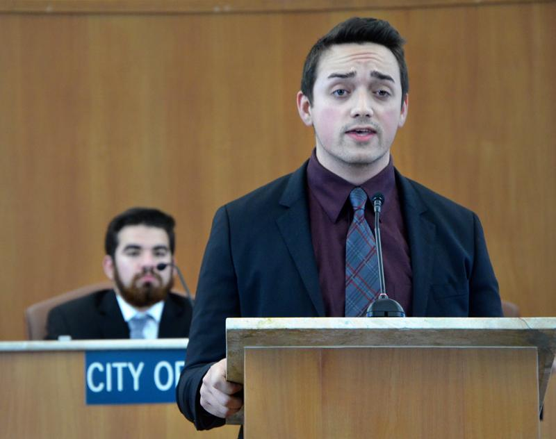 Debater Collin Brown speaks during the April 27 debate at Pittsburg City Hall.