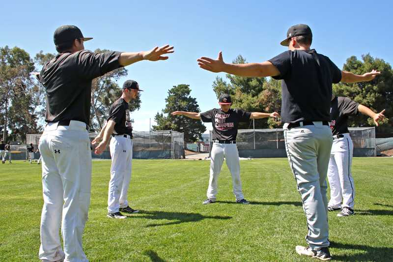 Five+LMC+baseball+players+are+warming+up+with+stretches+before+they+practice%2C+Mar.+30%2C+2016%2C+in+Pittsburg%2C+Calif.+