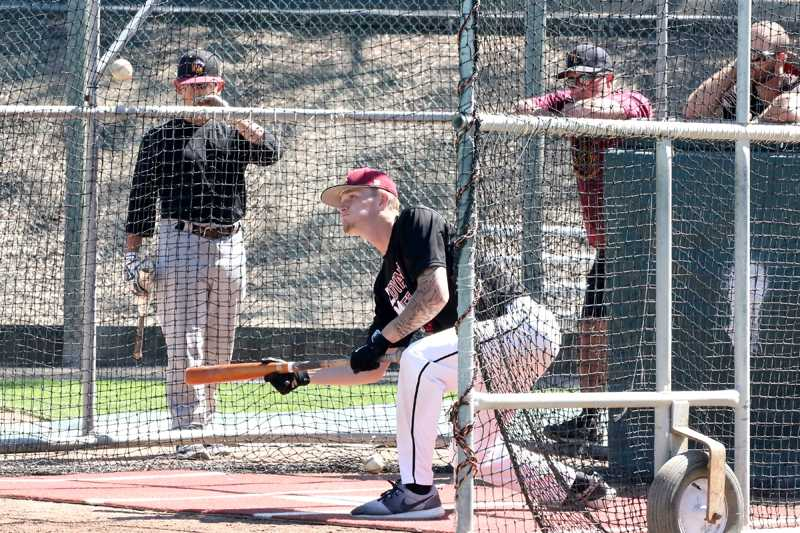 LMC+baseball+player+Gabe+Taylor+practices+his+bunting+style+while+other+players+look+and+learn%2C+Apr.+1%2C+2016%2C+in+Pittsburg%2C+Calif