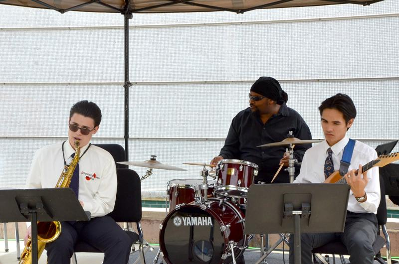 LMC students (left to right) Karmin Ortiz, Tyron Duncan and Frankie Trono provide music to the students and staff during the United Faculty's 40 year celebration Wednesday May 4.