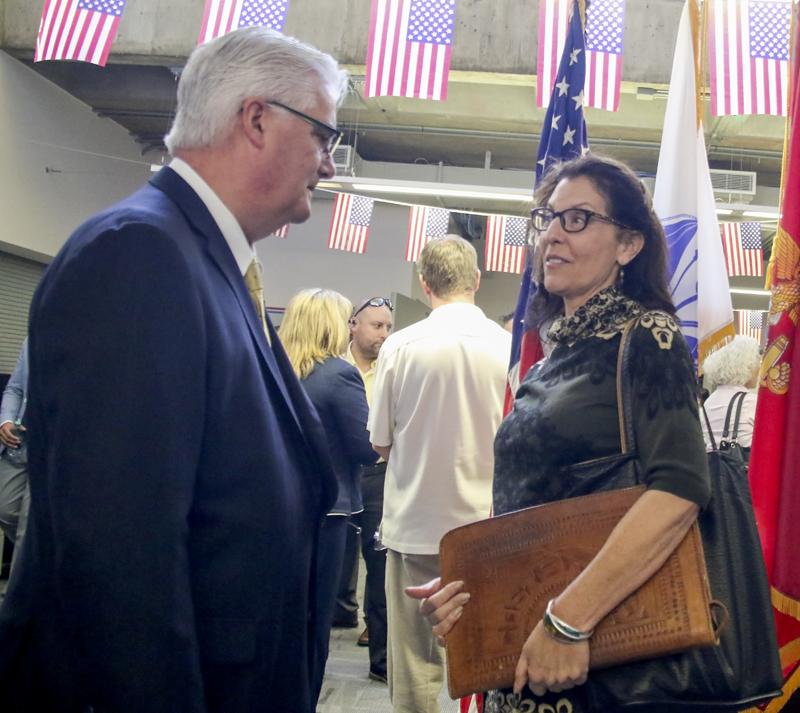 Veteran Center Opening Day. LMC, PIttsburg, Calif. Mike Conklin who is the Chairman for Sentinels Of Freedom Scholarship Foundation is talking with Laurie Huffman about the new facilities.