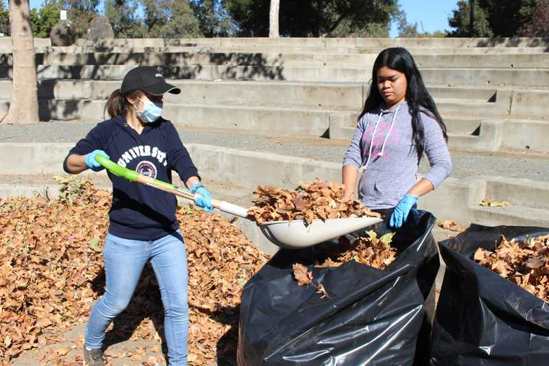 Los+Medanos+College+students+Diana+Sanchez+and+Ma.+Katrina+Samia+participate+in+a+cleanup+event+for+the+outdoor+amphitheater+Saturday%2C+Oct.+1.+LMC+students%2C+staff+and+faculty+are+working+on+making+more+use+of+the+space+while+speculating+on+its+future.+
