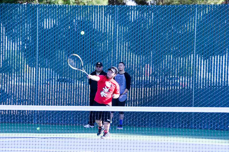 Los+Medanos+College%E2%80%99s+25+year+old+courts+were+remodeled+over+the+summer+and+early+fall+and+are+now+ready+for+use.+The+college+budgeted+%24500%2C000+for+the+project+and+funding+for+the+courts+came+from+the+Measure+E+Bond+funds.+The+courts+are+availble+for+use+by+the+public+and+college+community+from+morning+until+dusk.+Students+John+Salvador+and+Jeff+Calicdan+with+Athletic+Director+and+Tennis+Coach+Richard+Villegas+pictured+above+using+the+new+courts.