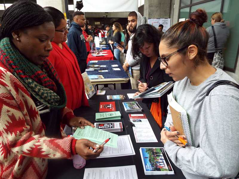 Students explore their options during Transfer Day Tuesday, Oct. 25 in the indoor quad.