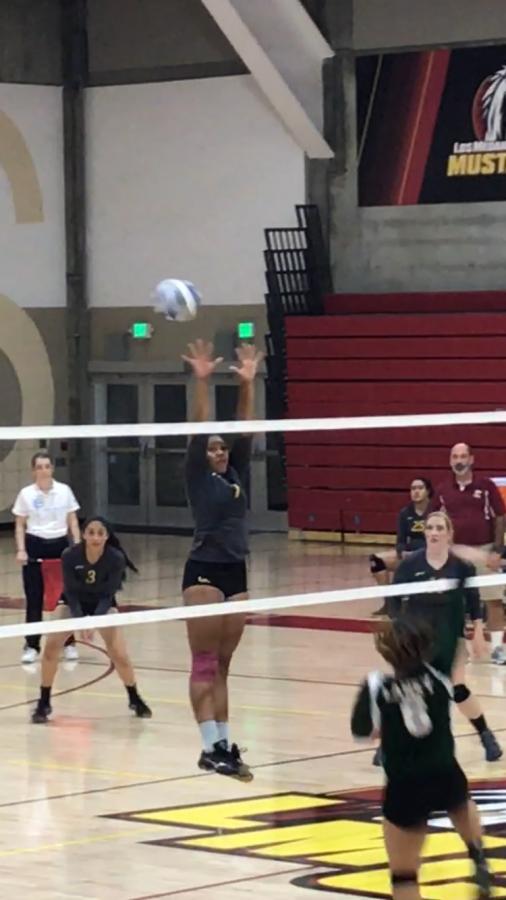 Ayana Burnett goes for a block.
