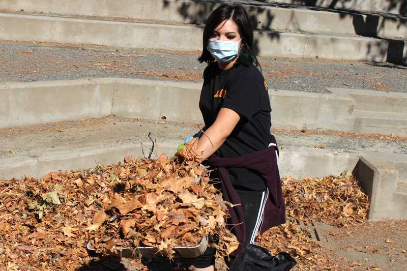 Natasha Garcia helps shovel leaves to clean up the amphitheater for last semester's movie screening night.