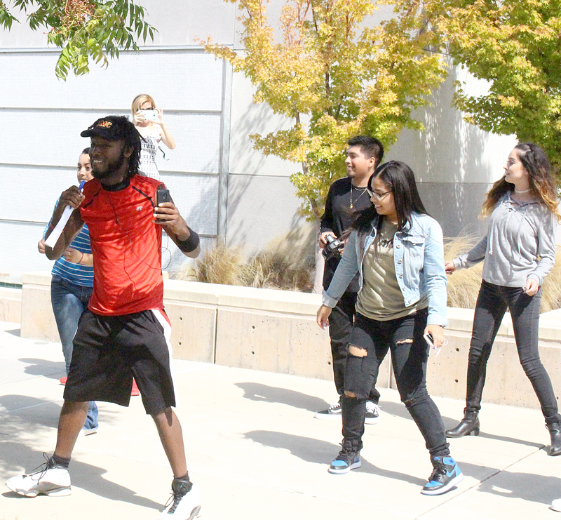 Puente performs a line dance routine during Club Day.