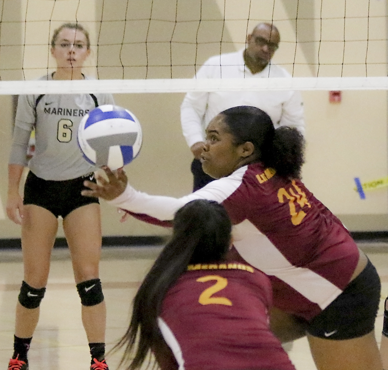 Erica Wilder rescues the ball for control.