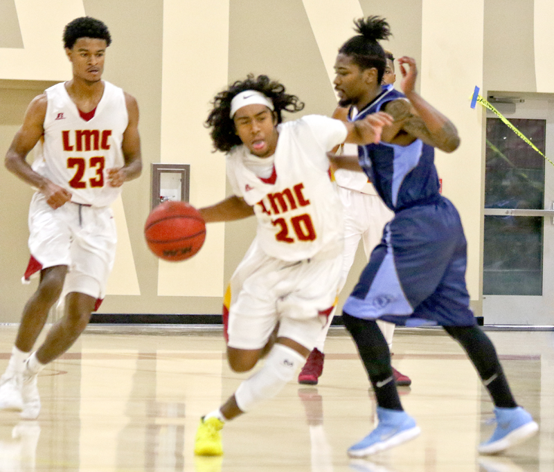 Los Medanos College's Raazhel Watkins makes his path away from a Contra Costa player.