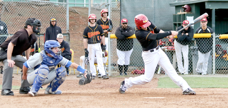 Los Medanos College at bat during their game against Modesto Junior College Friday, Jan 26. Despite their best efforts, the Mustangs lost the heated preseason game 3-2.