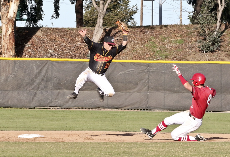LMC second baseman Jose Vasquez leaps into the air to catch the baseball during the Fresno City game on Friday.