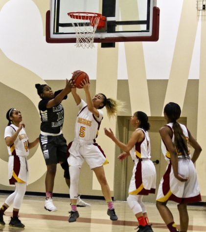Forward Jayden Tolentino jumps up to secure the rebound in a decisive game as the Mustangs push toward the playoffs.