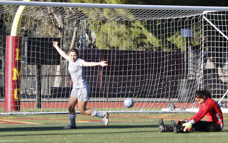 LMC Woman Soccer vs Merritt College. October 6, 2017. Merritt College Goal keeper # 7, Marielle Housedjissi looses balance while trying to stop LMC player #9 Adriana Urritia from making a goal. Urrutia makes goal. Los Medanos College, Pittsburg, Ca.