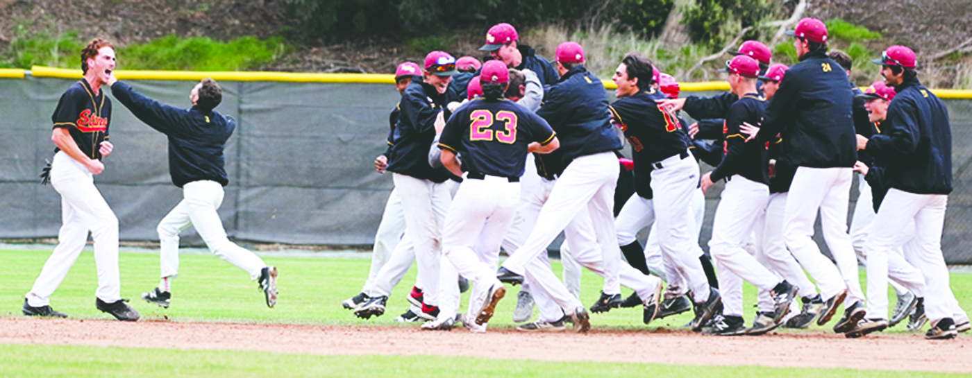 LMC celebrates its 4-3 victory over Napa Valley on Tuesday. Center fielder Jason Bray celebrates while teammates pile over Jack Downing who hit the walkout.