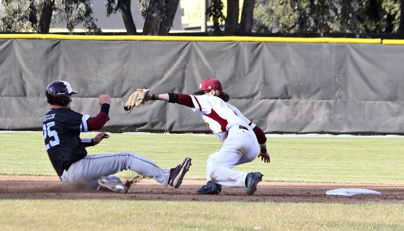 LMC vs. Monterey Pennisula College. On March 2, 2018. second baseman tags out Monterey player before he slides into base. Los Medanos College, Pittsburg, Calif.