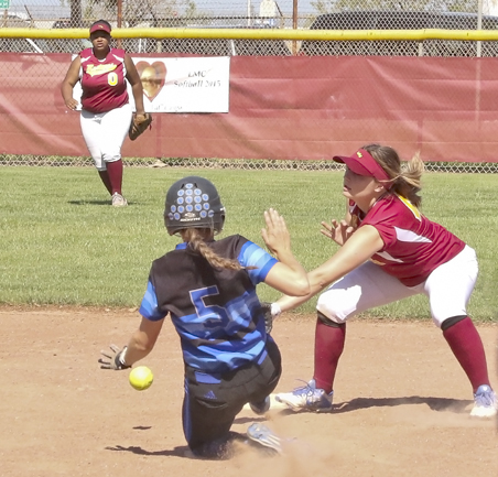 LMC vs. Solano Community College. LMC second baseman (#1 )  Mary Borlongan  trying to make the catch from outfielder (#28)  Shayna Lee before Solano County player (#5) Molly Schnurr makes it to the base. On April 24, 2018. Los Medanos College, Pittsburg, Ca.