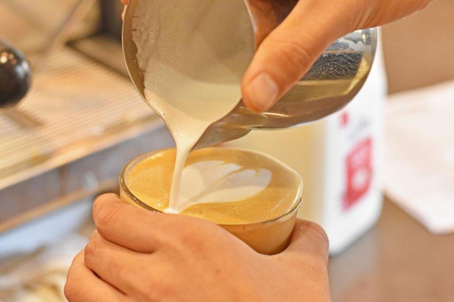 Barista makes coffee art.
