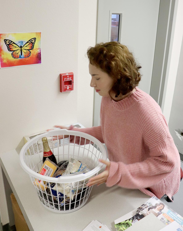 Jessica Wilson prepares basket for a student.
