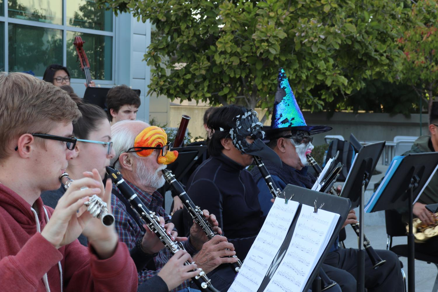 The brass section performs in costume during the impromptu concerto.