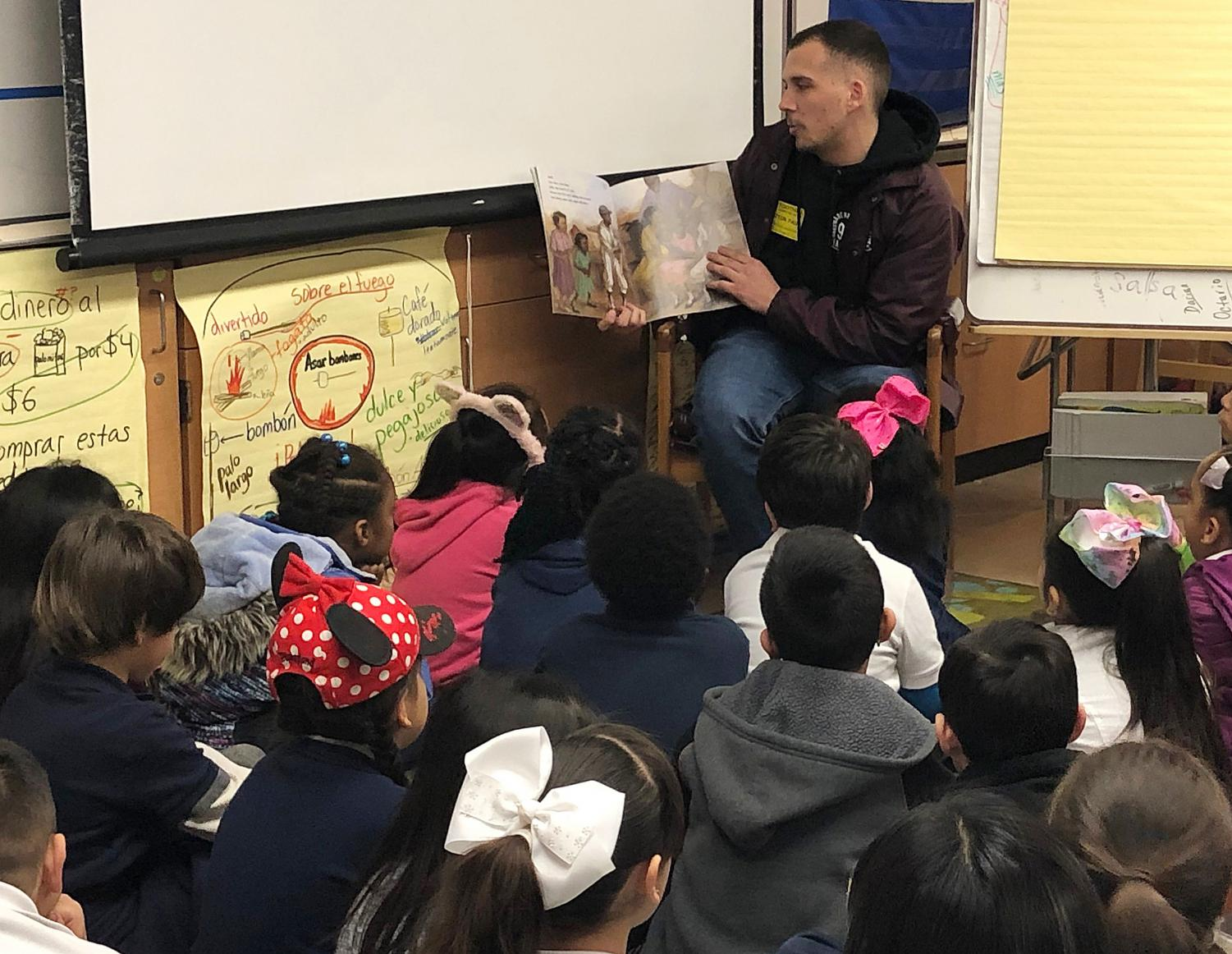 Zachary Castelluccio reads to a group of students.