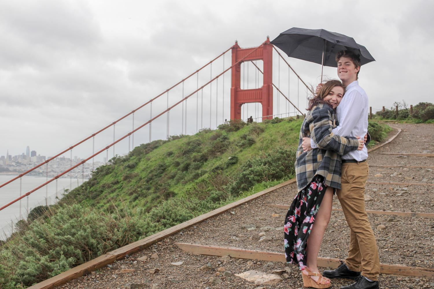 Lovers Jessica Rubin and Jacob Stenson taking in the view of the Golden Gate Bridge.