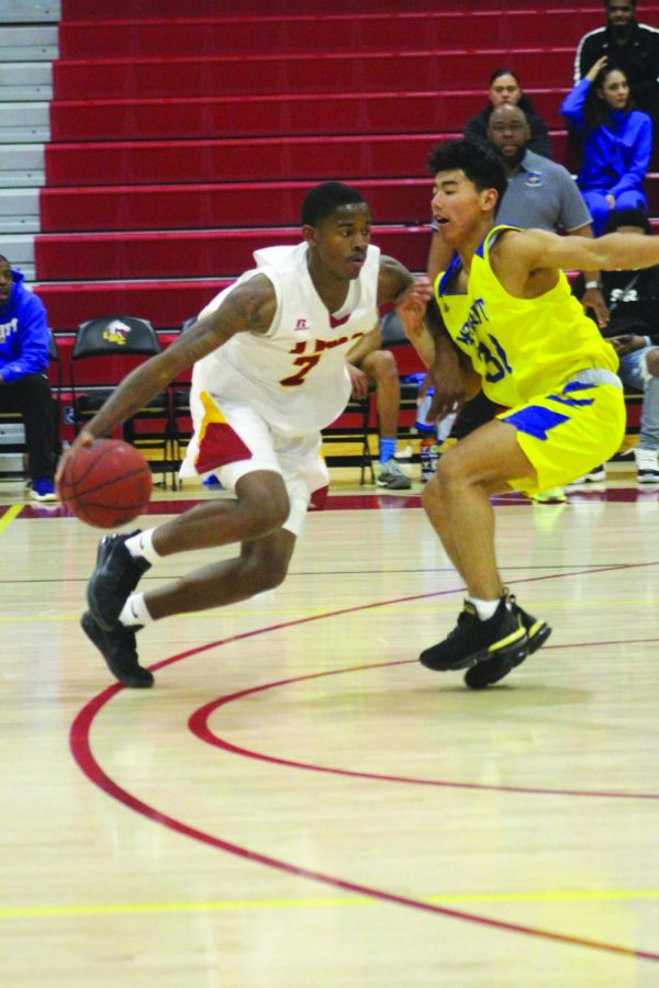 Mustangs' freshman Henry Sires dribbles past his Merritt College counterpart in LMC's 78-68 win.