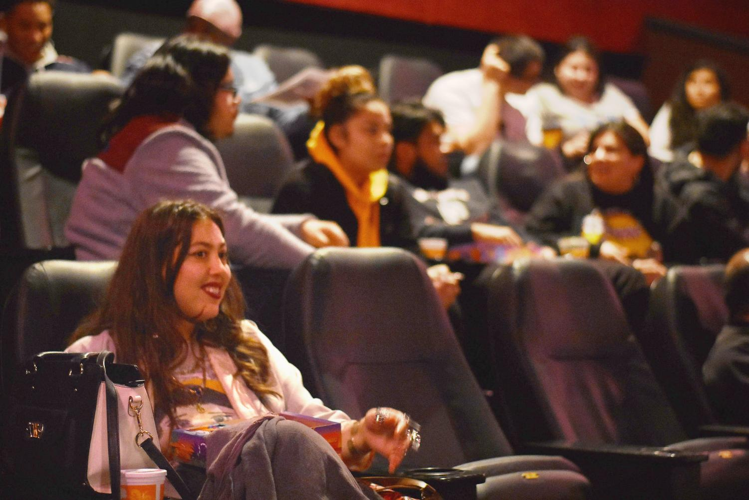 "Domonique Echeverria and other moviegoers in their seats await the premiere of ""Blindspotting."""
