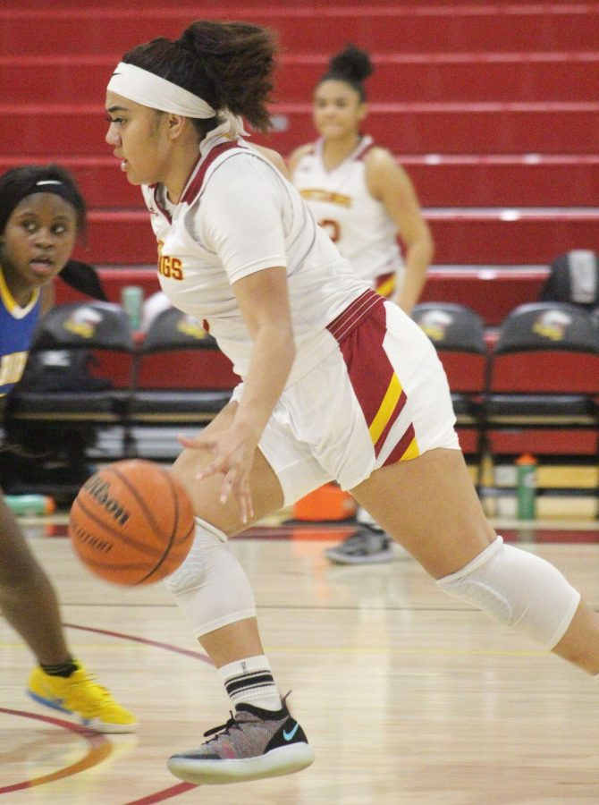 Seuvahnia Kuka dribbles the ball up the court in a home game against Merritt on Feb. 6.