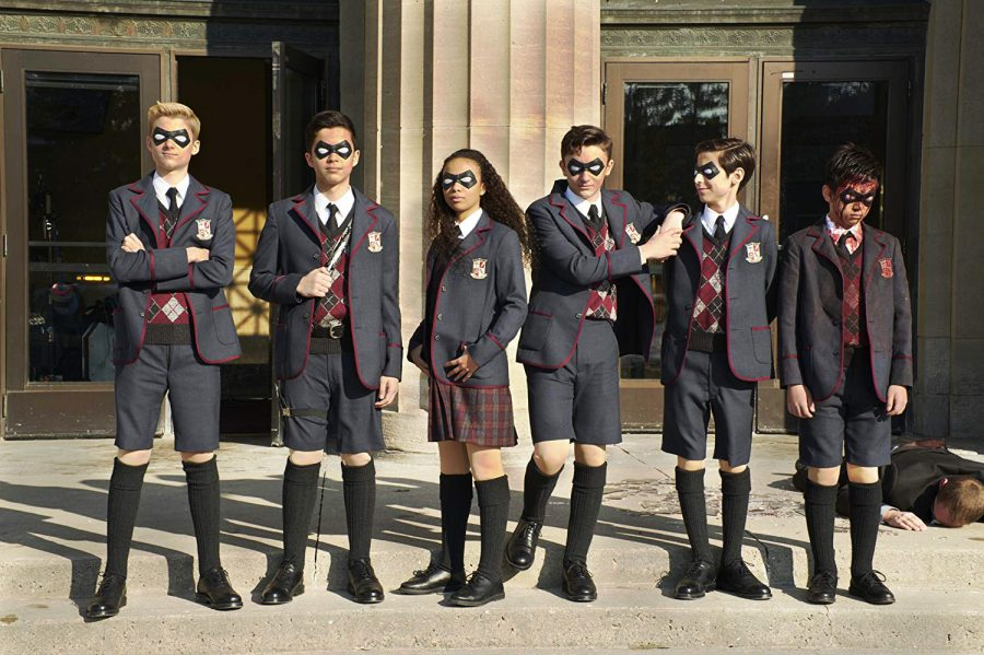 The six members of the Umbrella Academy are shown as their younger selves.