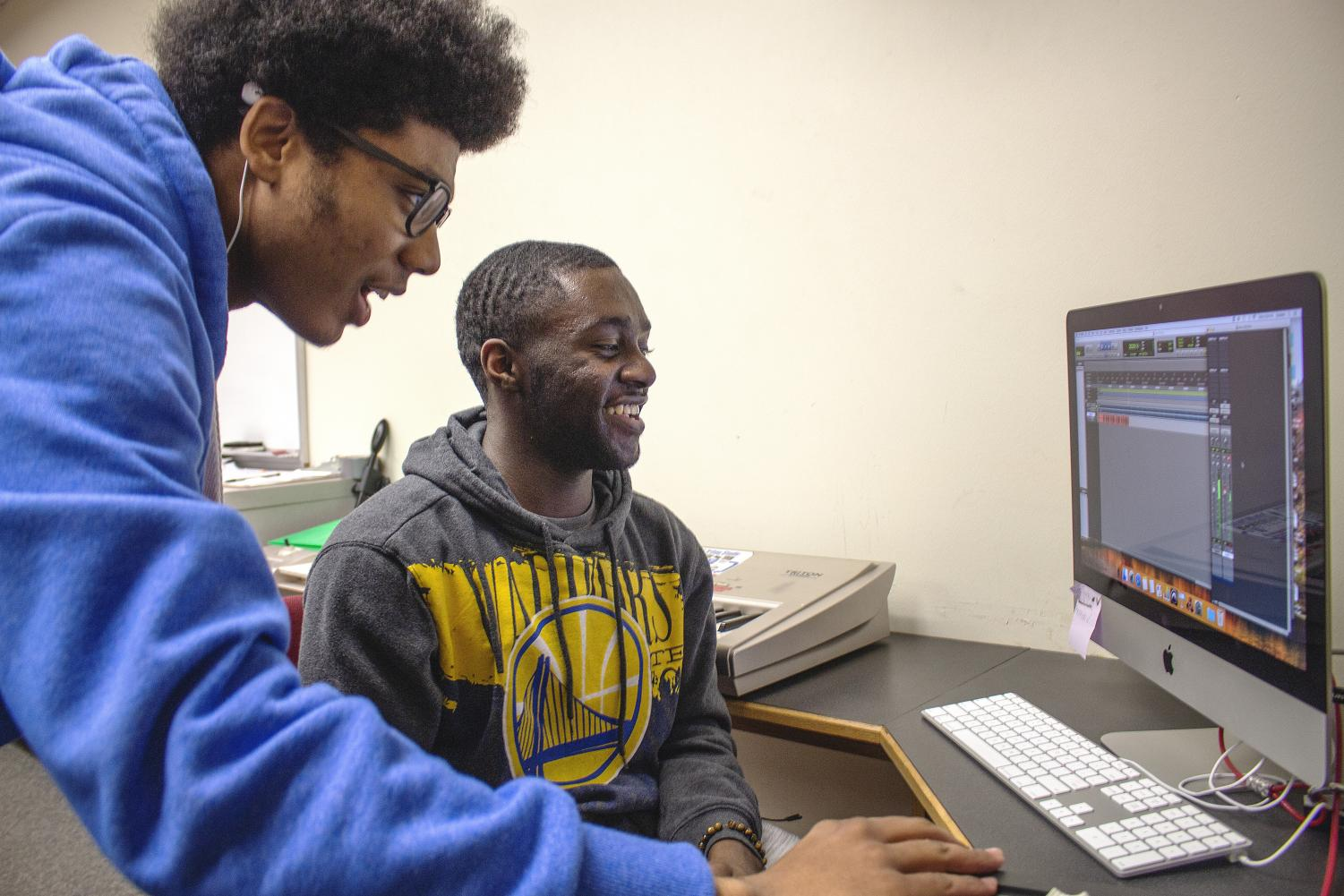 Los Medanos College Recording Arts students Devin Mason (left) and TJ Holloway work on incorporating a melody from a bass guitar into a project.