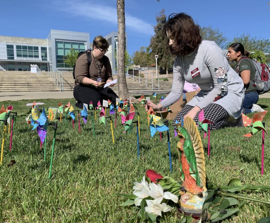 LMCAS Treasurer places pin wheels for lives lost to school shootings.