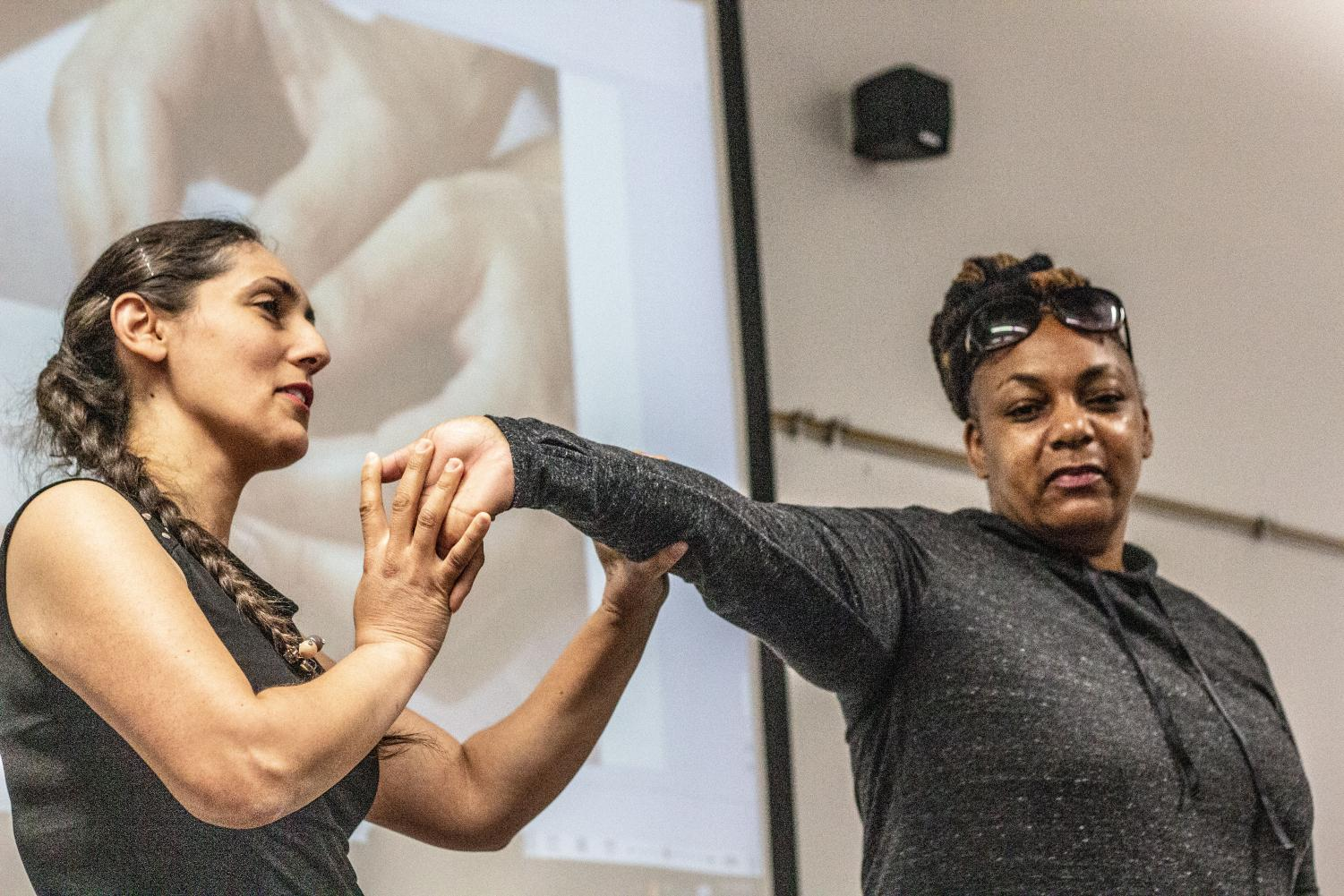 Biology professor Parisa Roghani demonstrates osteopathology on LMC student Luwanda Jordan.