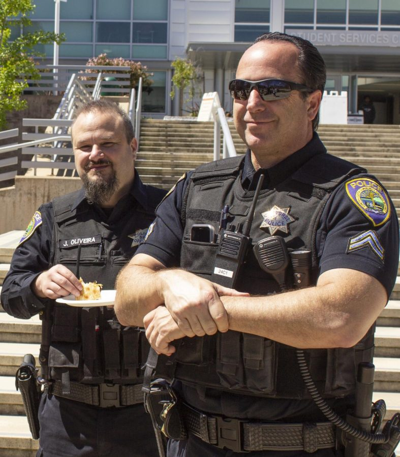 (Left) Officer Jose Oliveira and Officer David Oleski attend Pizza With a Cop.