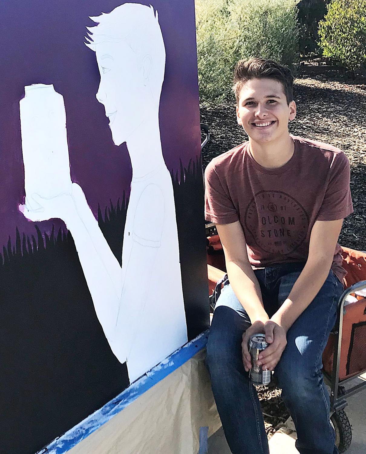 LMC student artist Matthew D'Amico in front of his painted utility box.