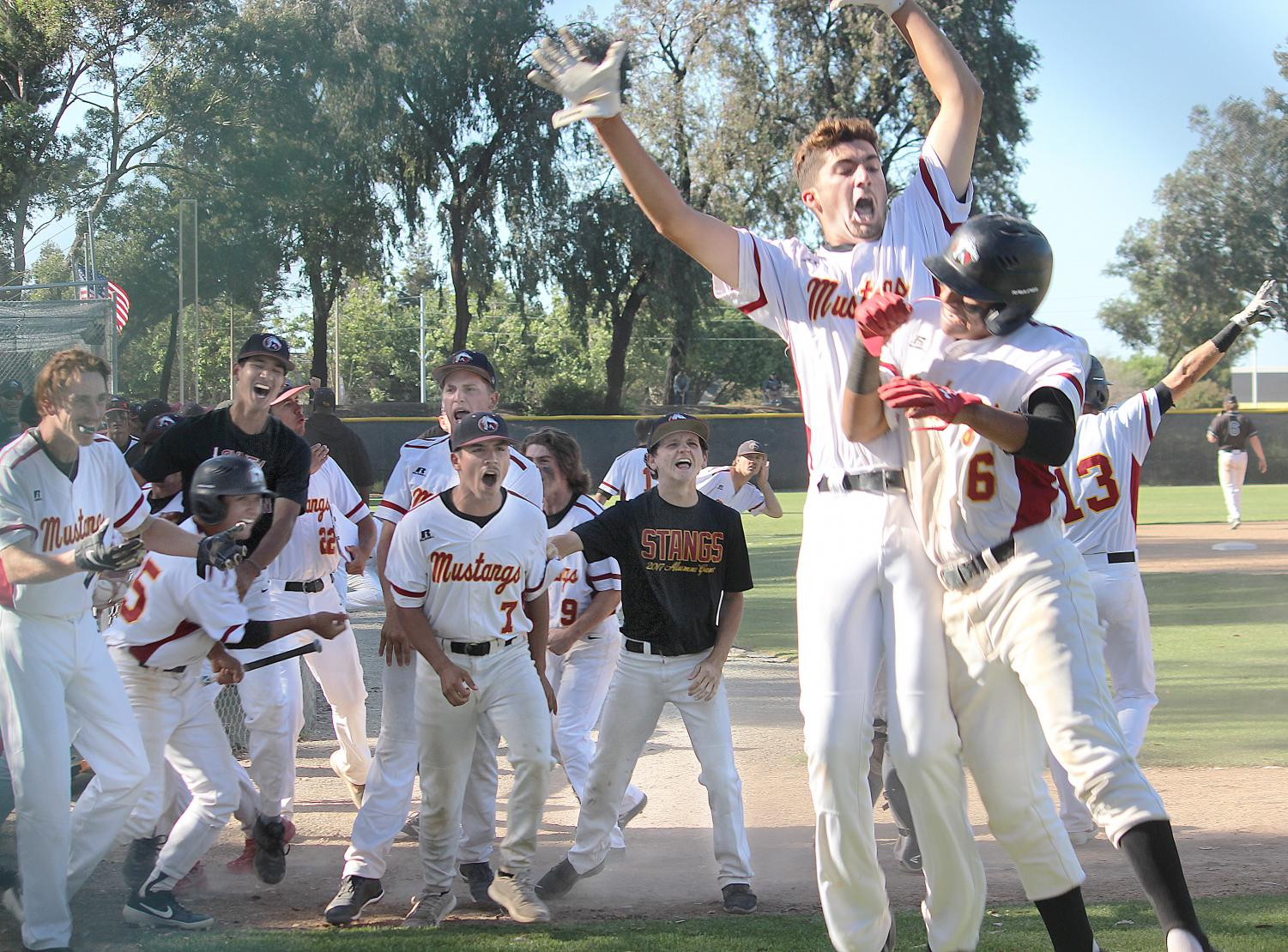 The LMC baseball team celebrates after it beat Mission college 11-7 May 4 to advance in the California Community College Athletics Association playoffs.