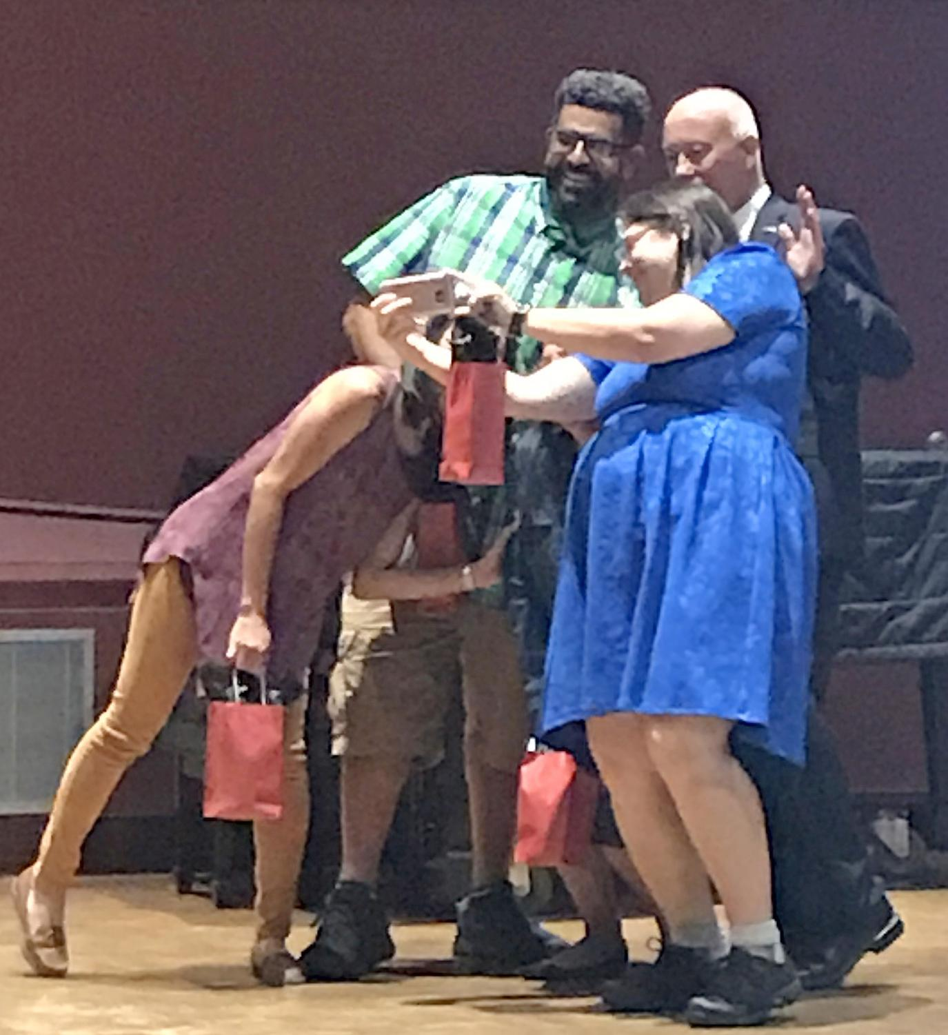 President Bob Kratochvil poses for a selfie with George Olgin, Adrianna Simone and Girlie Sison during LMC's Opening Day gathering in the Recital Hall Aug. 23.