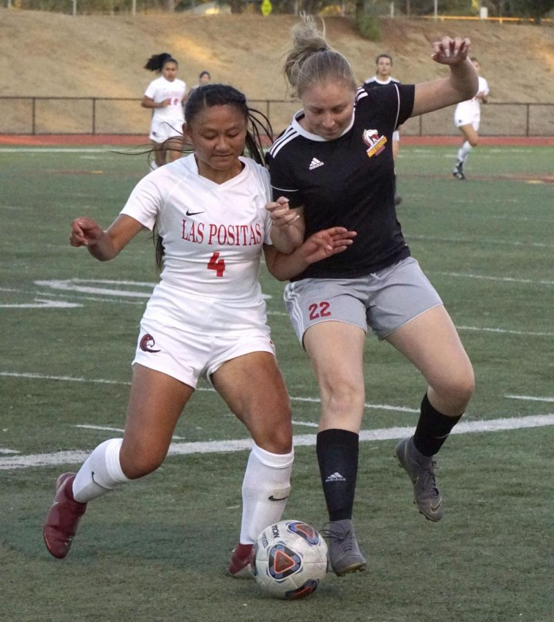 Jocelyn Guitierrez, No. 22, battles Alexis Xaysana, No. 4, for the ball during a soccer game on Sept. 11, 2019 at Los Medanos College in Pittsburg, Calif.