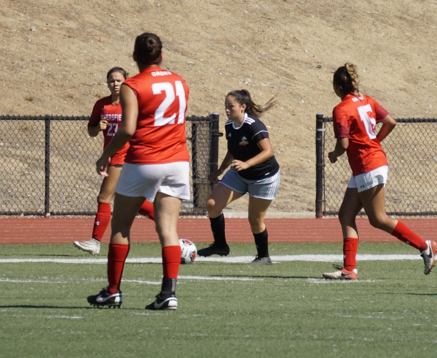 Jazmin Alanis, 2, takes on three Bakersfield College players during a soccer game on August 30, 2019 at Los Medanos College in Pittsburg, California.