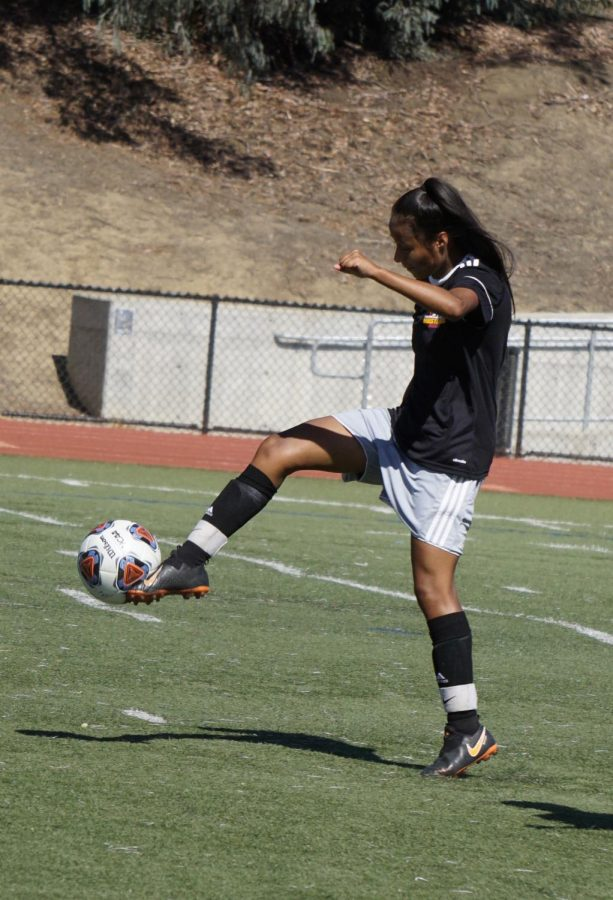 Nayeli Carbajal, 18, attempts to control the ball mid-air before going toward goal during a soccer game against Bakersfield College on August 30, 2019 at Los Medanos College in Pittsburg, California.