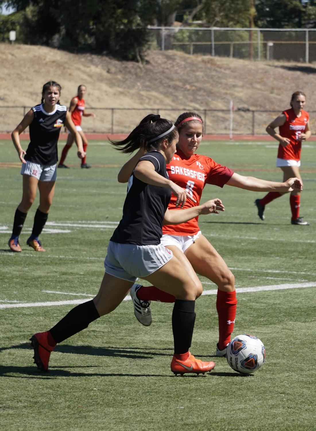 Nayeli Martinez, 26, defends the ball against a Bakersfield College offensive player during a soccer game on August 30, 2019 at Los Medanos College in Pittsburg, California.