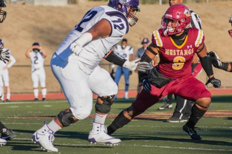Linebacker Heamasi Latu atempts to make a defensive play during a football game against San Jose City College Jaguars.