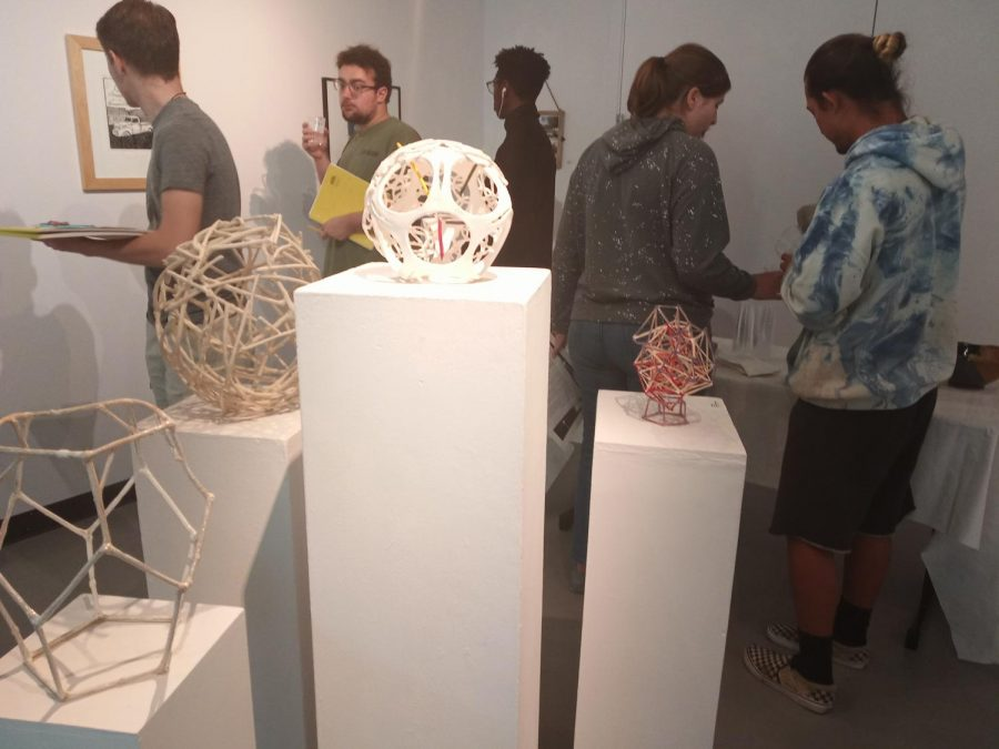 Art students visit the gallery during its opening reception Thursday, Sept. 12.