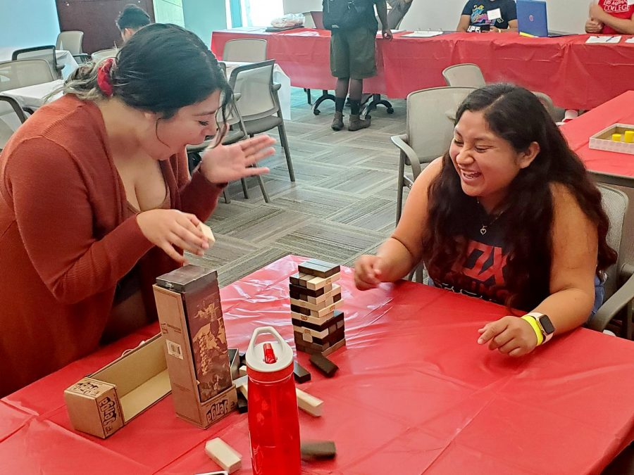 Jasmine Mejia (left) and Belem Naranjo (Right) playing Jenga.