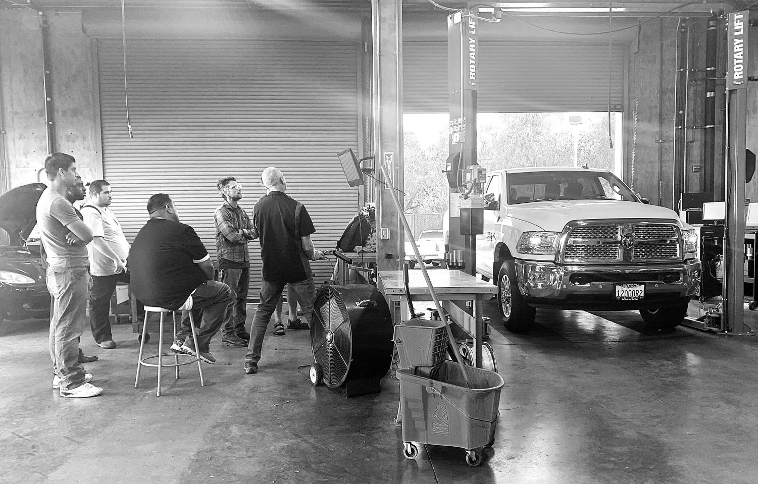 Automotive Instructor Stan Gozzi teaches his students how to diagnose issues in a diesel engine.